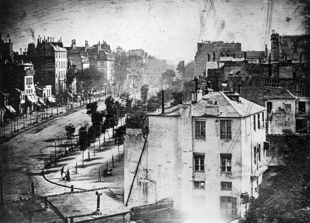 %22Boulevard du Temple%22, a daguerreotype made by Louis Daguerre in 1838, is generally accepted as the earliest photograph to include people.