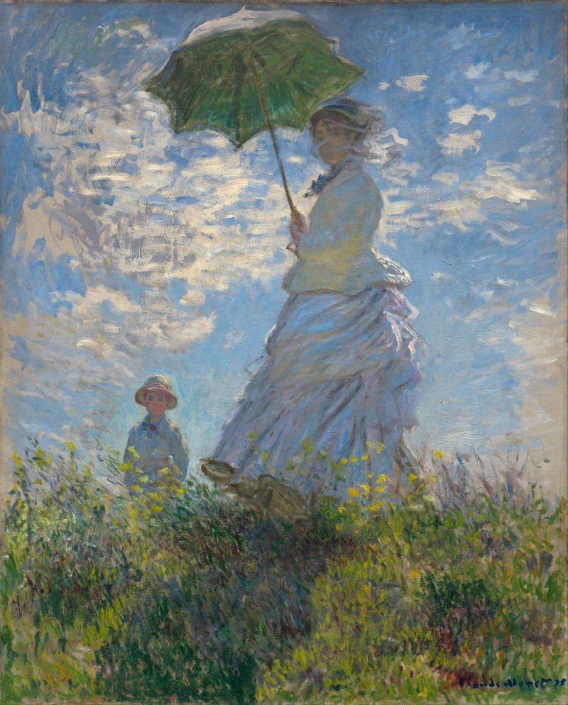 woman with a parasol madame monet and her son claude monet 1875